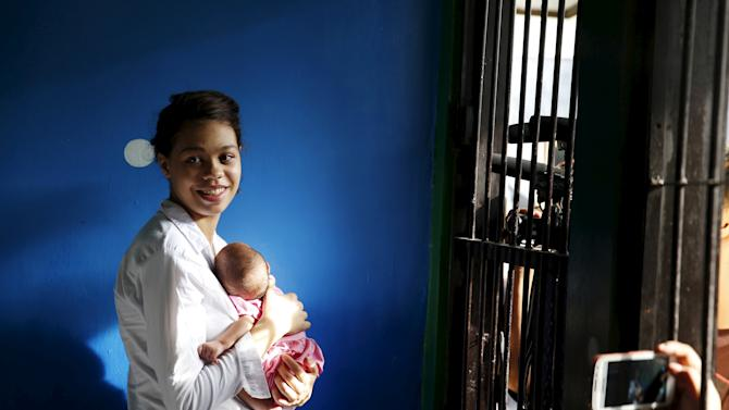 Heather Mack of the U.S. smiles after being reunited with her baby inside a holding cell at a Denpasar court following her verdict on the Indonesian resort island of Bali