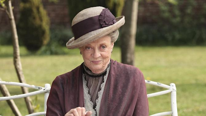 """FILE - In this image released by PBS, Maggie Smith as the Dowager Countess Grantham, is shown in a scene from the second season on """"Downton Abbey.""""  The fourth season of the popular British series will premiere in the U.S. on Jan. 5, 2014. (AP Photo/PBS, Carnival Film & Television Limited 2011 for MASTERPIECE, Nick Briggs)"""