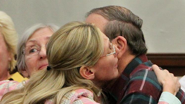 Jack Kern, right, embraces his daughter, Barbara, after the jury recommended death for Richard Beasley in the courtroom of Summit County Common Pleas Court Judge Lynne Callahan, Wednesday, March 20, 2013, in Akron, Ohio. Beasley, a self-styled street preacher, was convicted of killing three down-and-out men lured by bogus Craigslist job offers. (AP Photo/Akron Beacon Journal, Michael Chritton, Pool)
