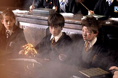 Daniel Radcliffe as Harry Potter looking on in shock as Seamus ( Devon Murray ) is surprised at the explosion of his wand in Warner Brothers' Harry Potter and The Sorcerer's Stone