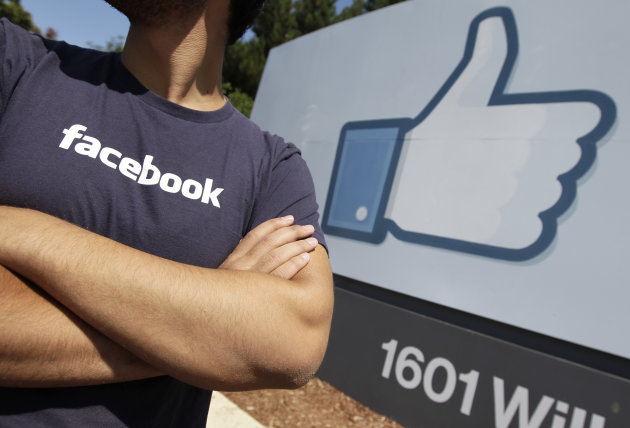 <p>               A Facebook worker waits for friends to arrive outside of Facebook headquarters in Menlo Park, Calif., Friday, Aug. 17, 2012. Facebook stock is trading at $19 and has lost half its market value since its May public offering. (AP Photo/Paul Sakuma)