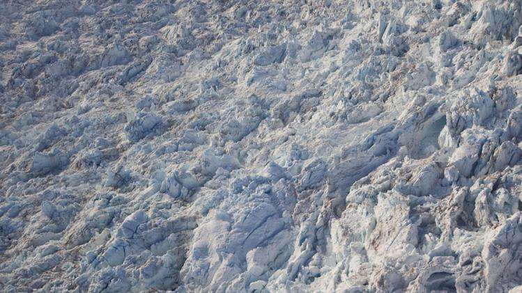 This July 19, 2011 photo shows the contoured surface of Jakobshavn Glacier at the fringe of the Greenland ice sheet. (AP Photo/Brennan Linsley)