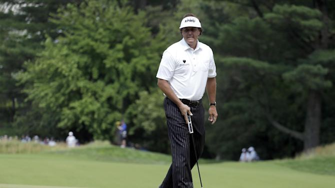 Phil Mickelson reacts to a missed putt on the first hole during the second round of the U.S. Open golf tournament at Merion Golf Club, Friday, June 14, 2013, in Ardmore, Pa. (AP Photo/Darron Cummings)