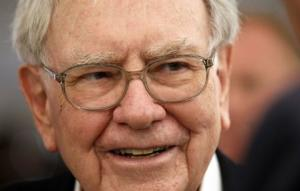 Berkshire Hathaway CEO Warren Buffett listens to a shareholder at the Berkshire-owned Borsheims jewelry store where Buffett was selling jewelry as part of the company annual meeting weekend in Omaha