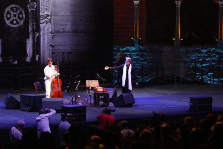 Lebanese composer and singer Marcel Khalife performs with cello player Sari Khalife during the Baalbek festival in Beirut