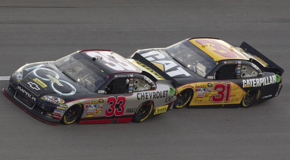 Clint Bowyer (33) leads Jeff Burton through Turn 2 during the NASCAR Sprint Cup Series auto race at Talladega Superspeedway in Talladega, Ala., Sunday, Oct. 23, 2011. Bowyer won the race. (AP Photo/Dave Martin)