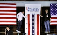 Campaign workers hang banners in preparation for a rally with Republican presidential candidate Mitt Romney April 24, in Manchester, New Hampshire. Romney effectively claimed the Republican presidential nomination, reveling in a five-state primary sweep and urging voters to help him oust President Barack Obama in November