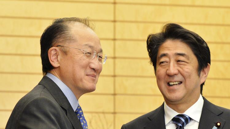 World Bank Group President Kim shakes hands with Japan's PM Abe before talks in Tokyo