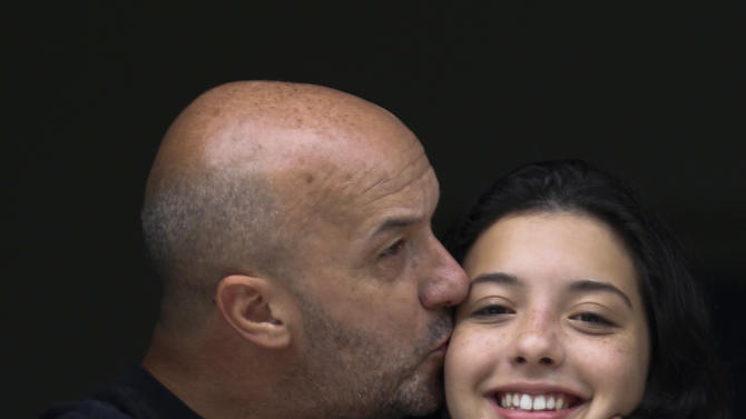 Former Caracas police commissioner Ivan Simonovis kisses his daughter at their house in Caracas