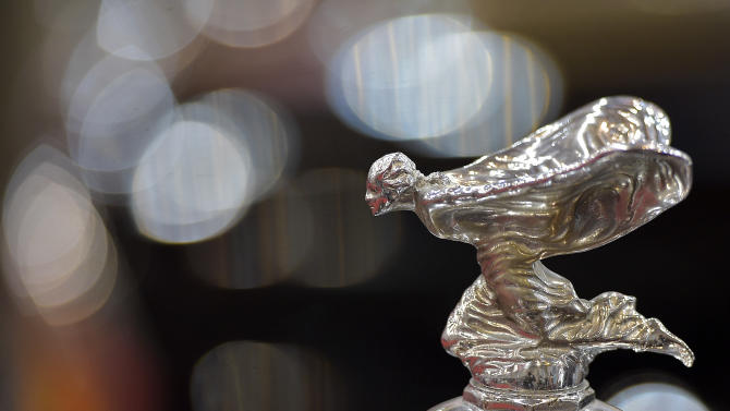 Emily, the hood ornament of Rolls Royce is pictured on a classic car at the Essen Motor Show, a show for tuning, motor sport, series sports vehicles and classic cars, in Essen, Germany, Friday, Nov. 28, 2014.  (AP Photo/Martin Meissner)