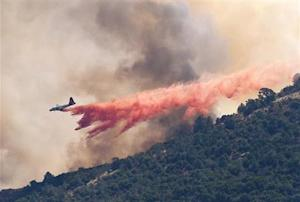 A plane drops fire retardant on the Morgan fire burning atop Mount Diablo as seen from Clayton