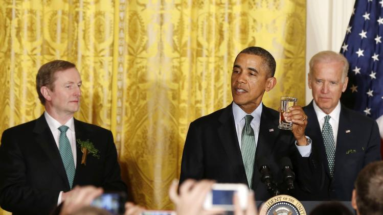 U.S. President Barack Obama offers a toast to Irish Prime Minister Enda Kenny as Vice President Joseph Biden watches during a St. Patrick's Day reception in Washington
