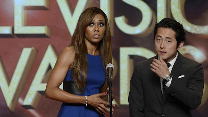 (L-R) Toks Olagundoye and Steven Yeun present a College Television Award onstage at the 34th College Television Awards presented by the Academy of Television Arts & Sciences Foundation at the JW Marriott Los Angeles L.A. Live on April 25, 2013 in Los Angeles, California. (Photo by Phil McCarten/Invision for the Academy of Television Arts & Sciences/AP Images)