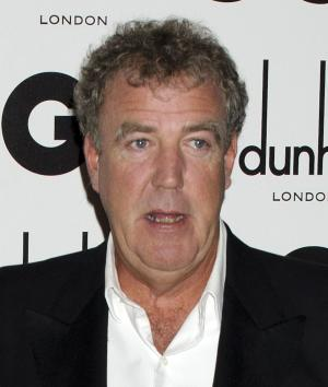 """FILE - In this Sept. 6, 2011 file photo, TV host Jeremy Clarkson arrives for the GQ Men of the Year Awards in London. """"Top Gear"""" host Jeremy Clarkson has apologized and asked for forgiveness following allegations that he used racist language while he was shooting an episode of the popular BBC show. The BBC said Friday May 2, 2014 it is taking the allegations seriously. (AP Photo/Jonathan Short, File)"""