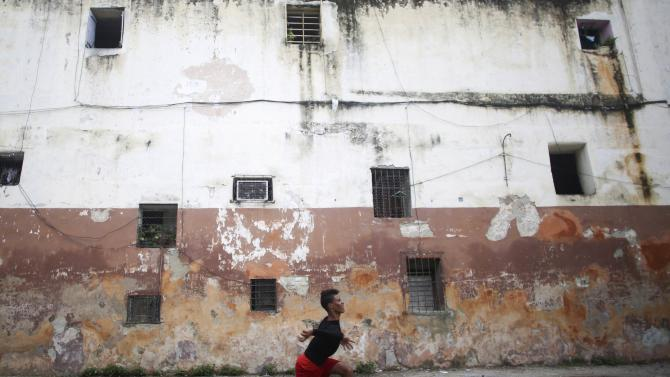 Student Ivan Ramos plays baseball in downtown Havana