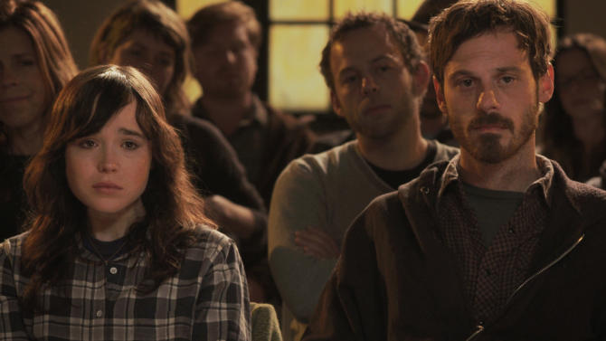 """This Dec. 4, 2012 publicity photo released by the Sundance Institute shows, Ellen Page, left, and Scoot McNairy, in a scene from the film, """"Touchy Feely,"""" by director, Lynn Shelton, included in the U.S. Dramatic Competition at the 2013 Sundance Film Festival.  The festival has 50-50 parity in directors, with eight women, eight men, among the 16 films in the competition, a record that female filmmakers consider a hopeful sign that they are making progress toward equal time with males. (AP Photo/Sundance Institute, Benjamin Kasulke)"""