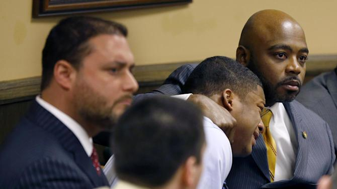 AP10ThingsToSee - Defense attorney Walter Madison, right, holds his client, 16-year-old Ma'Lik Richmond, second from right, while defense attorney Adam Nemann, left, sits with his client Trent Mays, foreground, 17, as Judge Thomas Lipps pronounces them both delinquent on rape and other charges after their trial in juvenile court in Steubenville, Ohio, Sunday, March 17, 2013. Mays and Richmond were accused of raping a 16-year-old West Virginia girl in August 2012. (AP Photo/Keith Srakocic, File)