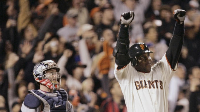 FILE - This Aug. 7, 2007 file photo shows San Francisco Giants' Barry Bonds, right, celebrating after hitting his 756th career home run against the Washington Nationals during the fifth inning of their baseball game in San Francisco. Looking on at left is Nationals' catcher Brian Schneider. Baseball's all-time home run king and its most decorated pitcher likely will be shut out of the Hall of Fame when the vote is announced in January. An AP survey shows that Barry Bonds and Roger Clemens, as well as Sammy Sosa, don't have enough votes to get into Cooperstown.  (AP Photo/Eric Risberg, File)