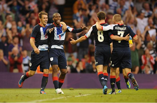 Daniel Sturridge (2nd left) celebrates with his team-mates after scoring against Uruguay