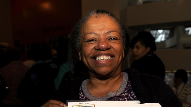 Bonnie Price of Detroit displays her stamps at the unveiling of the Rosa Parks' 100th birthday commemorative postage stamp at the Museum of African American History in Detroit on Monday, Feb. 4, 2013. The Rosa Parks Forever Stamp went on sale Monday and was part of a series of events scheduled throughout the day to honor her. AP Photo/The  Detroit News, David Coates)  DETROIT FREE PRESS OUT, HUFFINGTON POST OUT