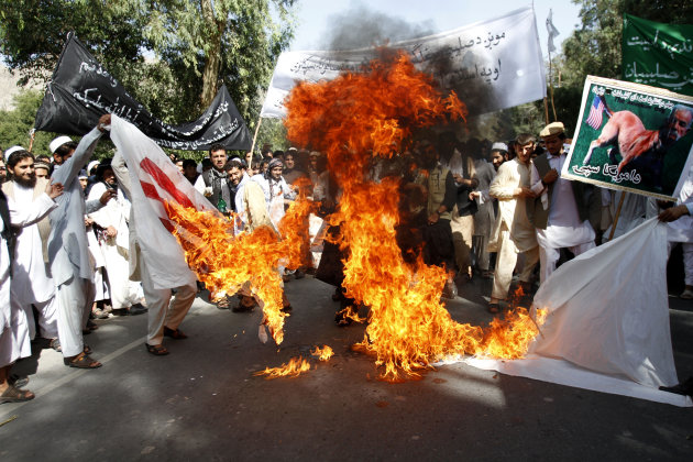 Afghan university students burn a U.S. flag in Surkhrod district of Nangarhar province, east of Kabul, Afghanistan, Wednesday, Sept 19, 2012. Hundreds of Afghans, some shouting &quot;Death to America&quot;, held a protest against an anti-Islam film in the eastern city of Jalalabad. (AP Photo/Rahmat Gul)