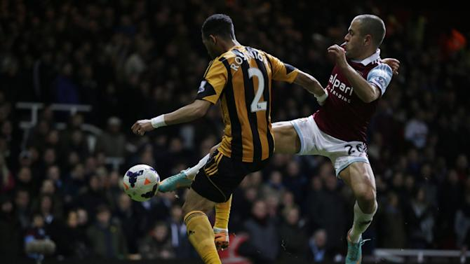 West Ham's Joe Cole, right, competes for the ball with Hull City's Liam Rosenior during the English Premier League soccer match between West Ham and Hull City at Upton Park stadium in London, Wednesday, March 26, 2014