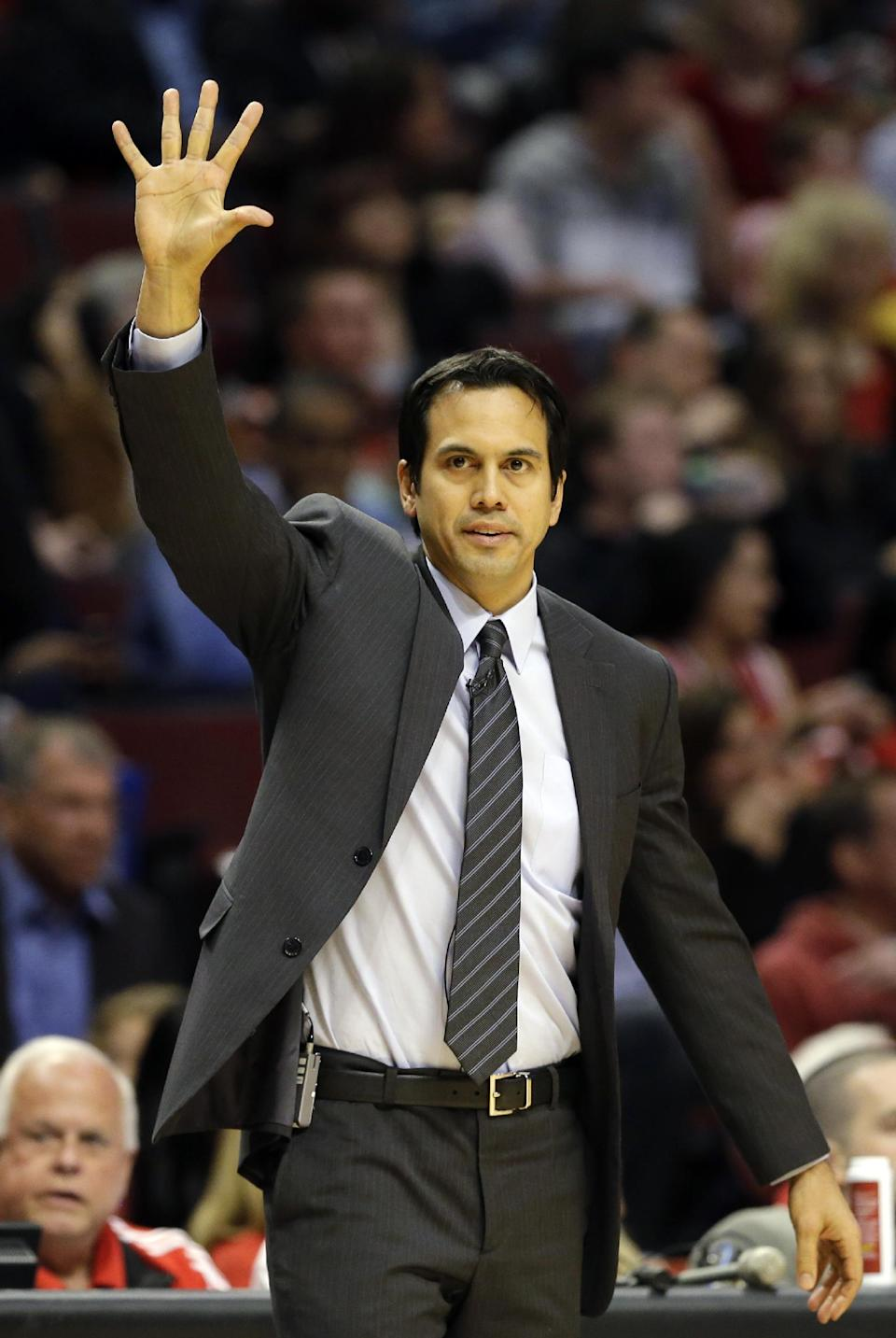 Miami Heat head coach Erik Spoelstra directs his team during the second half of Game 4 of an NBA basketball playoffs Eastern Conference semifinal against the Chicago Bulls on Monday, May 13, 2013, in Chicago. (AP Photo/Nam Y. Huh)