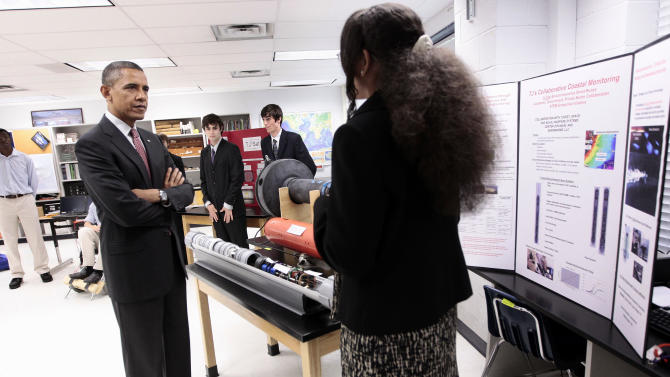 President Barack Obama listens to student Alexandria Sutton, 16, during his visit to a classroom at Thomas Jefferson High School for Science and Technology in Alexandria, Va., Friday, Sept. 16, 2011.(AP Photo/Pablo Martinez Monsivais)