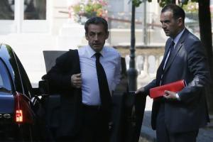 Former French President Nicolas Sarkozy arrives at the National Assembly in Paris