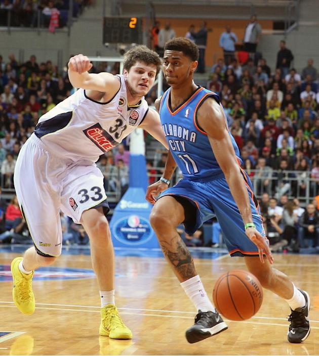 The NBA team Oklahoma City Thunder's Jeremy Lamb, right, attacks as James Metecan Birsen of Fenerbahce Ulker defends during a basketball game in Istanbul, Turkey, Saturday, Oct. 5, 2013. Oklahoma City