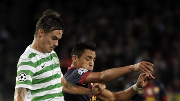 Celtic's Mikael Lustig, left, challenges FC Barcelona's Alexis Sanchez, of Chile, during a Champions League Group G soccer match at the Camp Nou, in Barcelona, Spain, Tuesday, Oct. 23, 2012.