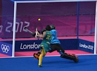 Australia's midfielder Kieran Govers scores past Britain's goalkeeper James Fair during the men's field hockey bronze medal match at The Riverbank Arena in London. Australia won 3-1