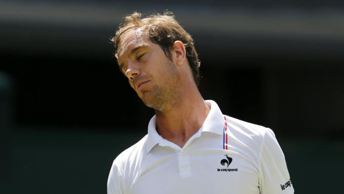 Richard Gasquet of France reacts during his match against Grigor Dimitrov of Bulgaria at the Wimbledon Tennis Championships in London