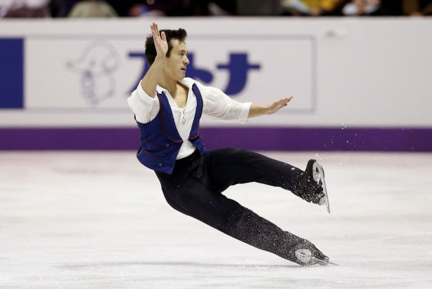Patrick Chan of Canada falls as he performs his men's free program at the ISU World Figure Skating Championships in London
