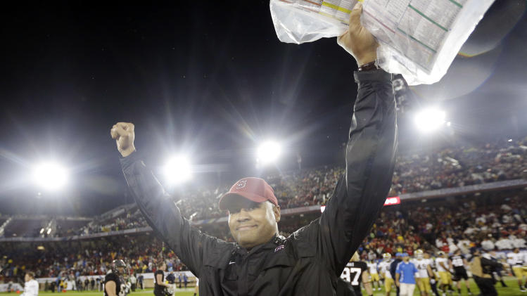 Stanford head coach David Shaw celeberates after a 27-24 win over UCLA during the Pac-12 championship NCAA college football game in Stanford, Calif., Friday, Nov. 30, 2012. (AP Photo/Marcio Jose Sanchez)