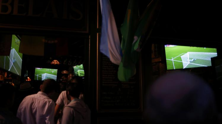 France team soccer fans gather to watch a live broadcast of the 2014 World Cup Group E soccer match between Ecuador and France at the Maracana stadium in Rio de Janeiro, at a bar in Nantes