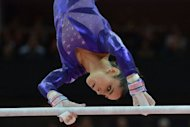 US gymnast Alexandra Raisman performs on the uneven bars during the women's qualification of the artistic gymnastics event of the London Olympic Games at the 02 North Greenwich Arena in London. Jordyn Wieber's dream of emulating her World Championship title with Olympic gold ended in tears on Sunday as she failed to qualify for the women's artistic gymnastics individual all-around final