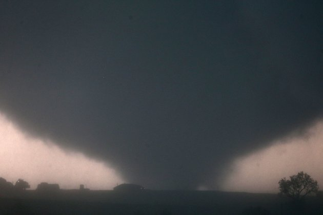 A tornado touches down near El Reno, Okla., Friday, May 31, 2013, causing damage to structures and injuring travelers on Interstate 40. I-40 has been closed after severe weather rolled through the area. (AP Photo/The Omaha World-Herald, Chris Machian) MANDATORY CREDIT