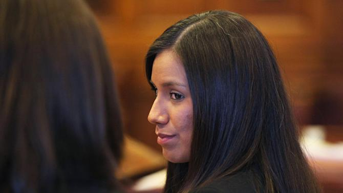 FILE - In this Oct. 9, 2012 file photo, Zumba fitness instructor Alexis Wright turns towards her attorney Sarah Churchill, left, during her arraignment in Portland, Maine on 109 counts including prostitution, violation of privacy and tax evasion for allegedly providing sex for money at her Kennebunk fitness studio and office. In the trial of her business partner, Mark Strong Sr., the jury watched a video Thursday, Feb. 28, 2013, showing a sexual encounter between Wright and a man who left cash on her massage table. Strong is charged with 13 counts that relate to promoting prostitution.  He contends he had an affair with Wright and helped her launch her Pura Vida dance studio in Kennebunk, Maine, but his lawyer has said he was unaware of any paid sex.  (AP Photo/Joel Page, File)