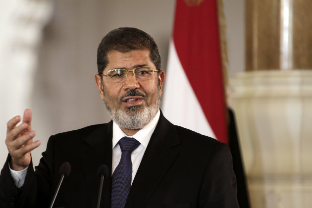 FILE - In this Friday, July 13, 2012 file photo, Egyptian President Mohammed Morsi holds a joint news conference with Tunisian President Moncef Marzouki, unseen, at the Presidential palace in Cairo, E