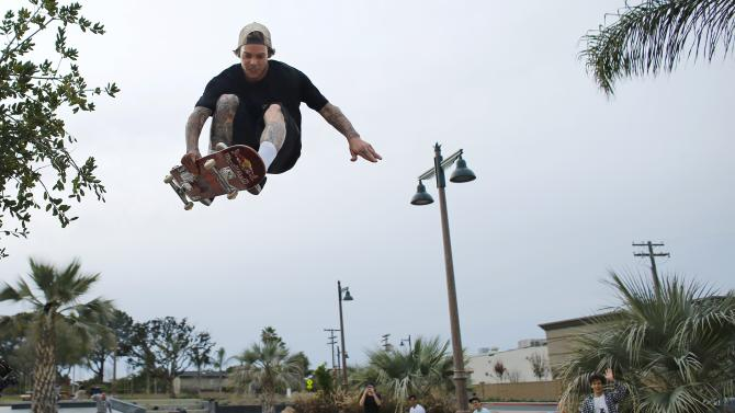 Professional skateboarder Ryan Sheckler rides his board through the air at a newly built skate park in Encinitas, California