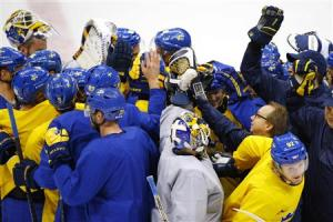 Sweden men's ice team gathers for a cheer at the end of a practice session at the 2014 Sochi Winter Olympics