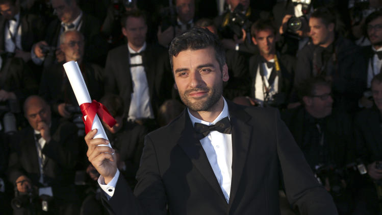 Actor Oscar Isaac poses with the Grand Prix award on behalf of directors Ethan and Joel Coen for their film Inside Llewyn Davis during a photo call after an awards ceremony at the 66th international film festival, in Cannes, southern France, Sunday, May 26, 2013. (Photo by Joel Ryan/Invision/AP)
