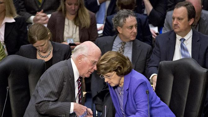Senate Judiciary Committee Chairman Patrick Leahy, D-Vt., and Sen. Dianne Feinstein, D-Calif., right, confer as lawmakers meet in a markup session to examine proposed changes to immigration reform legislation, on Capitol Hill in Washington, Thursday, May 9, 2013. A bill to enact dramatic changes to the nation's immigration system and put some 11 million immigrants here illegally on a path to citizenship is facing its first congressional test as lawmakers contest specifics in the 844-page legislation.  (AP Photo/J. Scott Applewhite)