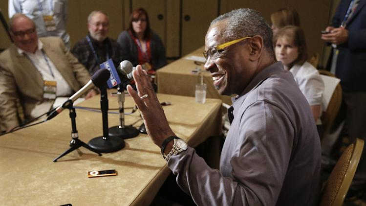 Cincinnati Reds manager Dusty Baker waves to a friend as he answers questions at the baseball winter meetings on Monday, Dec. 3, 2012, in Nashville, Tenn. (AP Photo/Mark Humphrey)