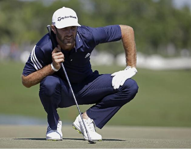 Dustin Johnson looks at his shot on the fourth green during the third round of the Cadillac Championship golf tournament Saturday, March 8, 2014, in Doral, Fla