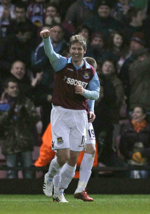 West Ham's Thomas Hitzlsperger celebrates scoring on his debut during the English FA Cup fifth round soccer match between West Ham and Burnley at Upton Park stadium in London, Monday, Feb. 21, 2011.