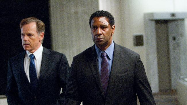 """This film image released by Paramount Pictures shows Bruce Greenwood portraying Charlie Anderson, left, and Denzel Washington portraying Whip Whitaker in a scene from """"Flight."""" Washington plays an airline pilot who, despite being hung-over, drunk and coked-up, manages to bring down a rapidly deteriorating plane in a daring emergency landing on what should have been a routine flight between Orlando, Fla., and Atlanta. (AP Photo/Paramount Pictures, Robert Zuckerman)"""