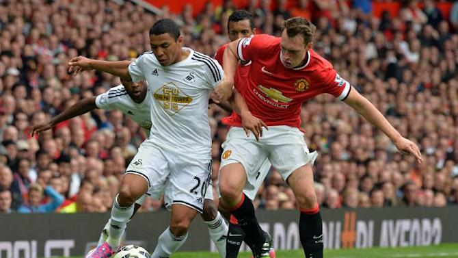 Manchester United's English defender Phil Jones (R) vies with Swansea City's Ecuadorian midfielder Jefferson Montero during the English Premier League match at Old Trafford in Manchester, north-west England on August 16, 2014