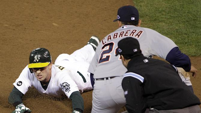 Oakland Athletics' Stephen Drew is out at third on a tag by Detroit Tigers third baseman Miguel Cabrera after hitting an RBI double to score Coco Crisp in the sixth inning of Game 4 of their American League division baseball series in Oakland, Calif., Wednesday, Oct. 10, 2012. (AP Photo/Eric Risberg)